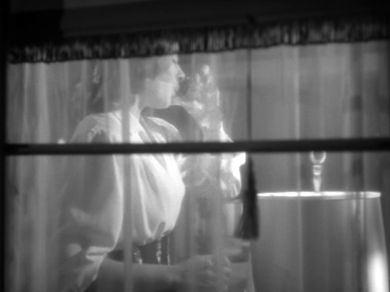 Fig. 12: Alicia taking a drink behind the curtained window.