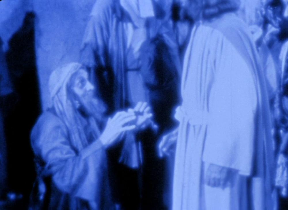 Fig. 13. Den kurerede tigger går ned på knæ for Jesus.