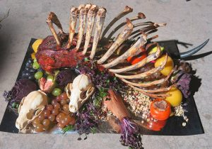 Fig. 10: Poon's lavish and unsettling rack of lamb from the season 2 finale. Notice how the skulls are incorporated and how the upper ribs have been tied together to resemble a pair of praying hands.