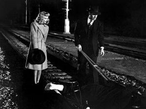 """Fig.1: Både jernbaneskinnerne og ordene """"end of the line"""" bliver for filmens publikum påmindelser om skæbnens uafvendelighed for Neff og Phyllis, efter at de har dræbt hendes mand."""