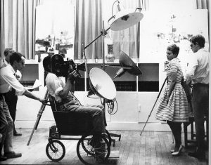 Fig. 11. Adieu au langage continues Godard's history of self-imposed aesthetic 'poverty' – here he is pushing Raoul Coutard in a wheel chair on the set of À bout de souffle.