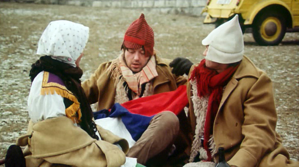 Fig. 16: Birds, Orphans, and Fools (Juraj Jakubisko, 1969). Jakubisko's own abivalence towards his ethnic identity is a running theme throughout the film. Here the film's protagonists sit in front of the tomb of Milan Štefánik, a general and national symbol in the First Republic, and pledge their allegience to each other and madness.
